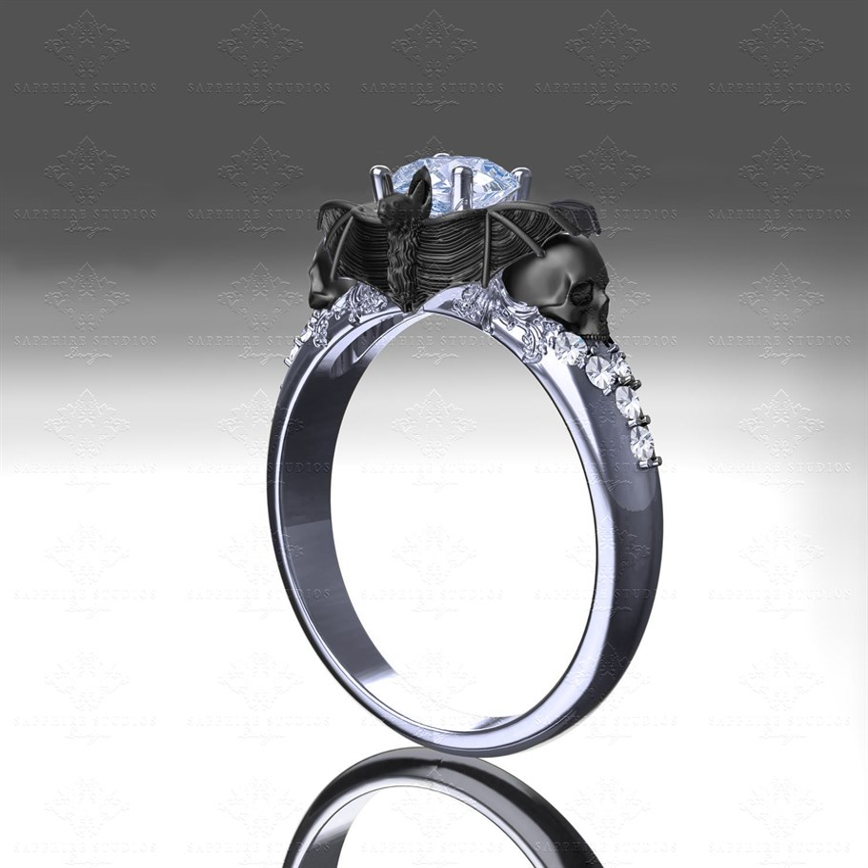 Moonlight 140ct WhiteBlack Gold Bat and Skull Engagement Ring