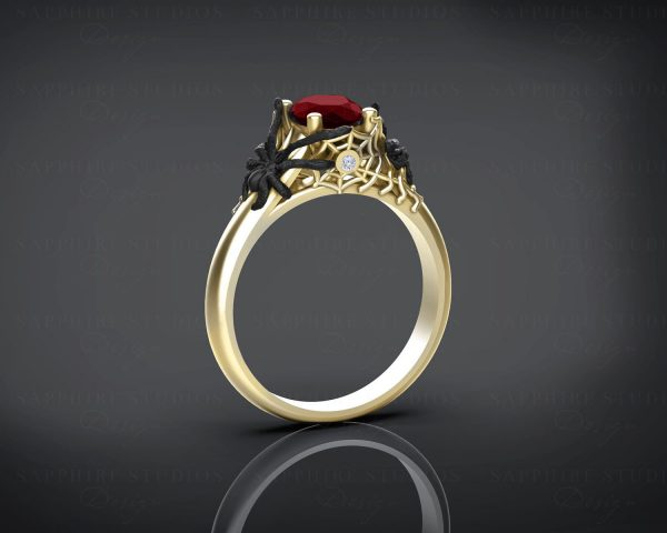 aranea-natural-garnet-yellow-gold-spider-engagement-ring